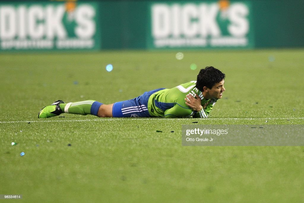 <a gi-track='captionPersonalityLinkClicked' href=/galleries/search?phrase=Fredy+Montero&family=editorial&specificpeople=5563695 ng-click='$event.stopPropagation()'>Fredy Montero</a> #17 of the Seattle Sounders FC grimaces in pain on the pitch during the MLS match against the New York Red Bulls on April 3, 2010 at Qwest Field in Seattle, Washington. The Red Bulls defeated Sounders FC