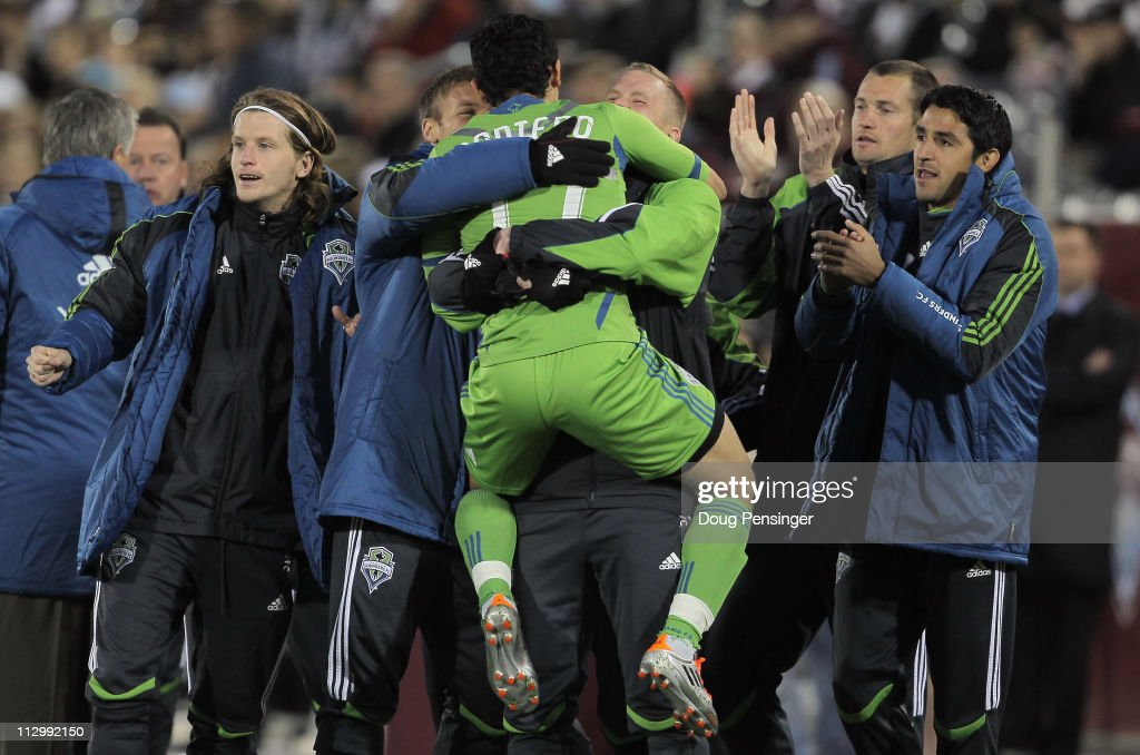 <a gi-track='captionPersonalityLinkClicked' href=/galleries/search?phrase=Fredy+Montero&family=editorial&specificpeople=5563695 ng-click='$event.stopPropagation()'>Fredy Montero</a> #17 of the Seattle Sounders FC jumps into the arms of his teammates as he celebrates his goal against the Colorado Rapids in the 19th minute at Dick's Sporting Goods Park on April 22, 2011 in Commerce City, Colorado.