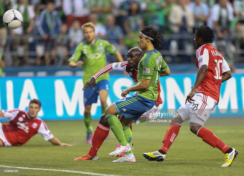 <a gi-track='captionPersonalityLinkClicked' href=/galleries/search?phrase=Fredy+Montero&family=editorial&specificpeople=5563695 ng-click='$event.stopPropagation()'>Fredy Montero</a> #17 of the Seattle Sounders FC scores a goal against the Portland Timbers at CenturyLink Field on October 7, 2012 in Seattle, Washington.