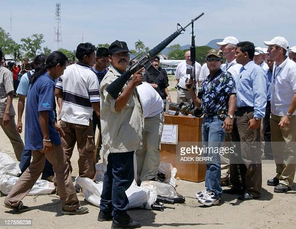Free Aceh Movement hand over their weapons during a disarmament ceremony in Banda Aceh 15 September 2005 Separatist rebels in Indonesia's Aceh...