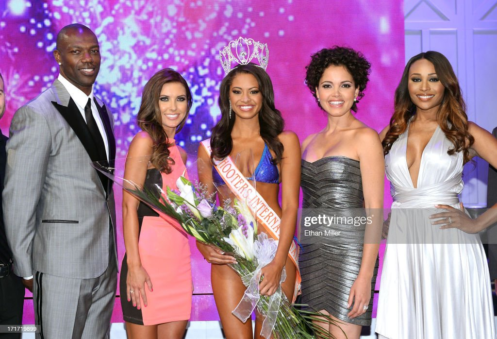 NFL free agent and pageant judge Terrell Owens, television personality and pageant judge Audrina Patridge, Marissa Raisor of Newport, Kentucky, Miss USA 2003 and pageant judge Susie Castillo and model and pageant judge Cynthia Bailey pose onstage after Raisor was crowned Miss Hooters International 2013 at the 17th annual Hooters International Swimsuit Pageant at The Joint inside the Hard Rock Hotel & Casino on June 27, 2013 in Las Vegas, Nevada.