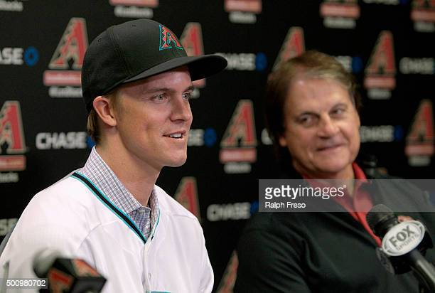 Free agent aquisition Zack Greinke of the Arizona Diamondbacks speaks to the media as Chief Baseball Officer Tony La Russa looks on during a press...