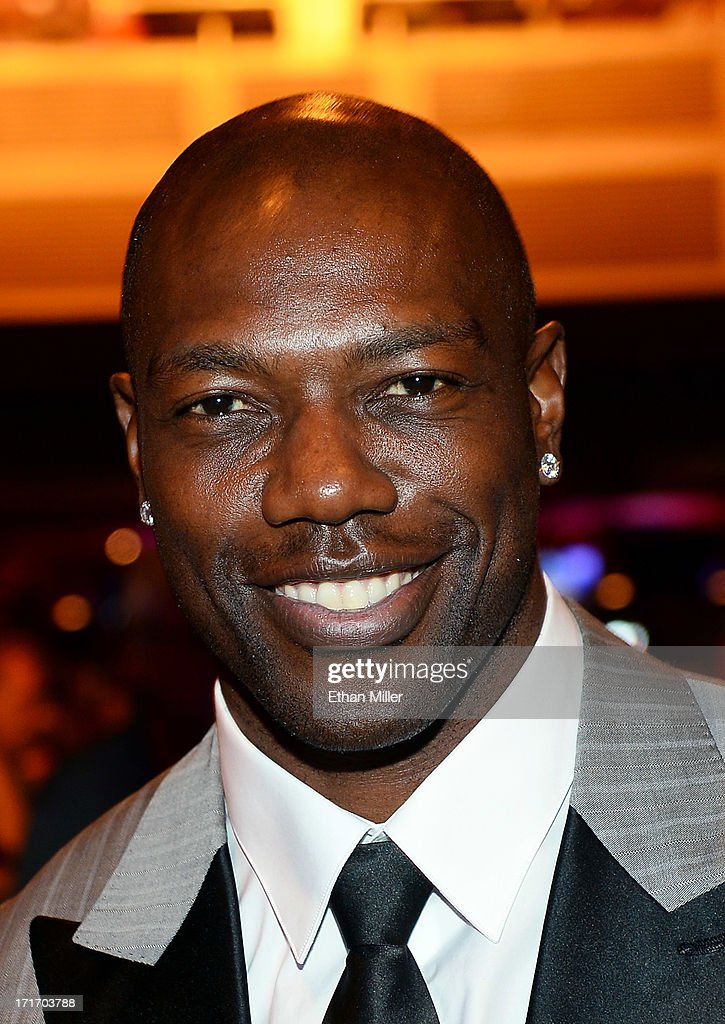 NFL free agent Terrell Owens appears before the 17th annual Hooters International Swimsuit Pageant at The Joint inside the Hard Rock Hotel & Casino on June 27, 2013 in Las Vegas, Nevada.