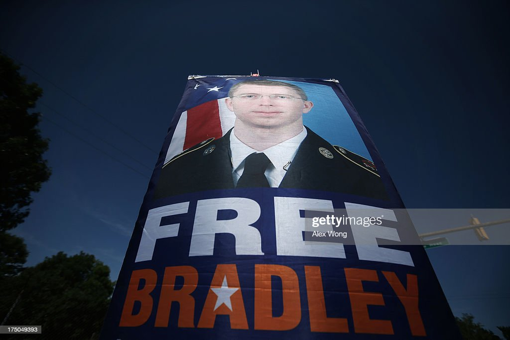 A free Bradley Manning sign is seen during a demonstration outside the main gate of Ft. Meade July 30, 2013 in Maryland. Military Judge Col. Denise Lind, who is presiding in the case of United States vs. Pfc. Bradley E. Manning, has reached a verdict and she is scheduled to read the verdict at 1pm today. Manning could face a life sentence for charges of espionage, aiding the enemy and computer fraud, for passing classified documents to WikiLeaks.