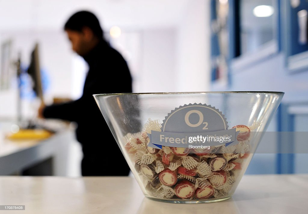 Free candy sits in a bowl inside an O2 Mobile Phone Store, part of Telefonica SA, on Grafton Street in Dublin, Ireland, on Wednesday, June 12, 2013. Telefonica SA, Europe's most indebted telephone company, is seeking initial bids for its Irish unit within the month, two people with knowledge of the matter said. Photographer: Aidan Crawley/Bloomberg via Getty Images