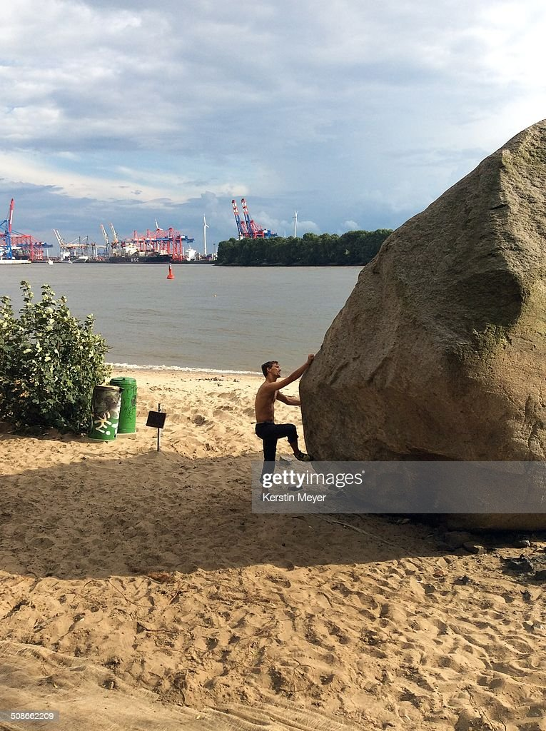Free climbing exercise at beach in Hamburg, Germany on