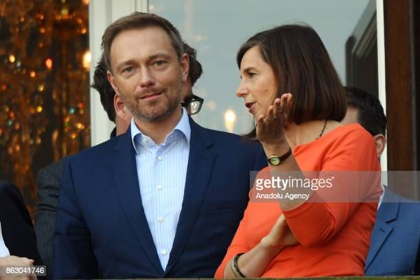 Free Democrats Party Leader Christian Lindner Green Party Faction CoLeader Katrin GoeringEckardt chat on a balcony of a Reichstag building during...