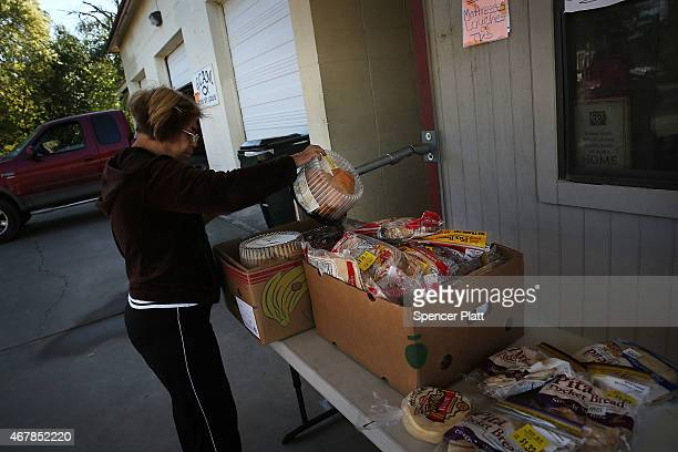 Free food is viewed on a table at a food pantry operated by Gonzales Christian Assistance Ministry one of the few social services organizations in...