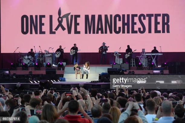 SALES free for editorial use In this handout provided by 'One Love Manchester' benefit concert Miley Cyrus and Ariana Grande perform on stage on June...