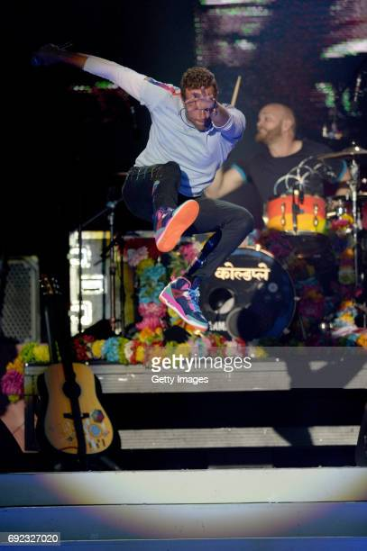 SALES free for editorial use In this handout provided by 'One Love Manchester' benefit concert Chris Martin of the Coldplay performs on stage on June...