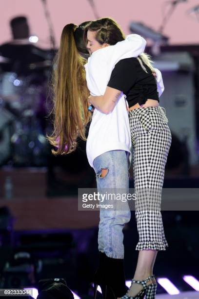 SALES free for editorial use In this handout provided by 'One Love Manchester' benefit concert Ariana Grande and Miley Cyrus perform on stage on June...