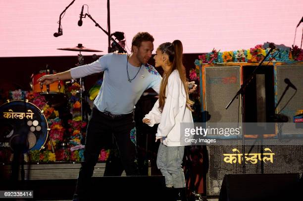 SALES free for editorial use In this handout provided by 'One Love Manchester' benefit concert Chris Martin and Ariana Grande perform on stage on...