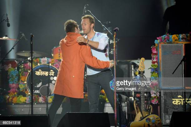 SALES free for editorial use In this handout provided by 'One Love Manchester' benefit concert Liam Gallagher and Chris Martin perform on stage on...