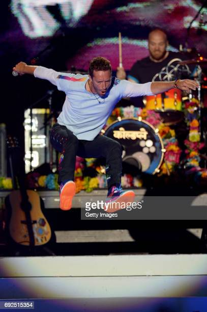 SALES free for editorial use In this handout provided by 'One Love Manchester' benefit concert Chris Martin of Coldplay performs on stage on June 4...