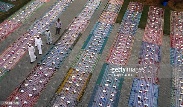 Free Iftar meals are laid out before foreign Muslim workers arrive to break their fast during the holy month of Ramadan in Dubai on July 15 2013...