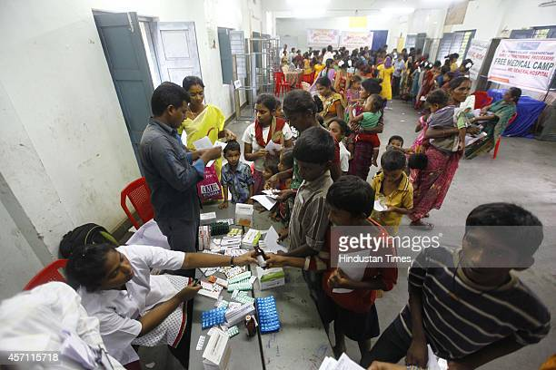 Free medical check held and free medicine distributed as a safety measure at Bheemili village on October 11 2014 in Visakhapatnam India Around 11...