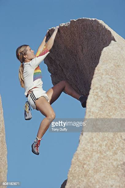Free mountain rock climber Carolynn Marie 'Lynn' Hill clings to the rockface during a climb on 1 June 1983 in Yosemite Valley California United States