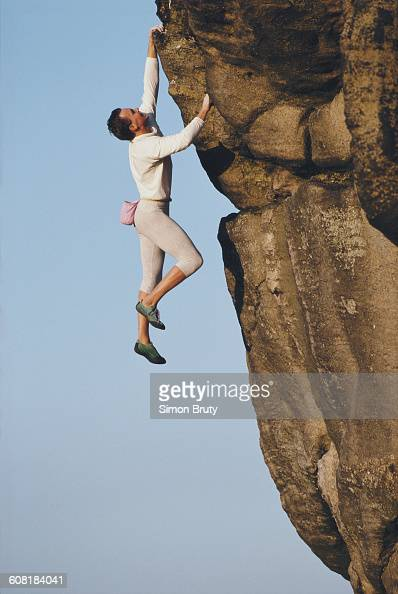 Free mountain rock climber John Dunne clings to the rockface during a climb on 1 June 1989 in Ilkley Yorkshire England