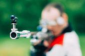 Free rifle sport shooting man. Focus on muzzle