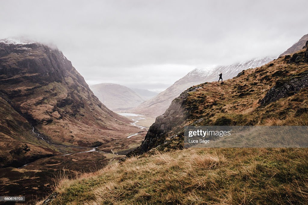 A free runner along a mountain landscape : Stock Photo