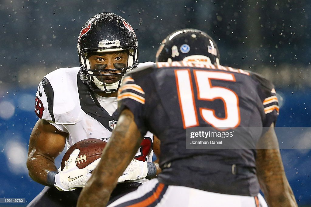 Free safety <a gi-track='captionPersonalityLinkClicked' href=/galleries/search?phrase=Danieal+Manning+-+American+Football+Player&family=editorial&specificpeople=589817 ng-click='$event.stopPropagation()'>Danieal Manning</a> #38 of the Houston Texans carries the ball against wide receiver Brandon Marshall #15 of the Chicago Bears during the game at Soldier Field on November 11, 2012 in Chicago, Illinois.