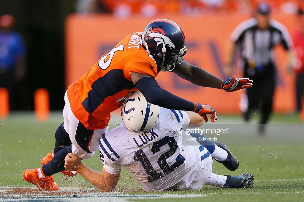Free safety Darian Stewart #26 of the Denver Broncos is called for unnecessary roughness for tackling quarterback Andrew Luck #12 of the Indianapolis Colts as he slides for a first down in the fourth quarter of the game at Sports Authority Field at Mile High on September 18, 2016 in Denver, Colorado.