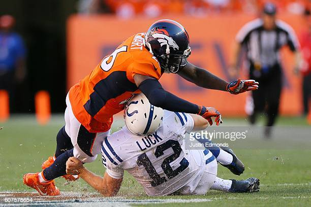 Free safety Darian Stewart of the Denver Broncos is called for unnecessary roughness for tackling quarterback Andrew Luck of the Indianapolis Colts...