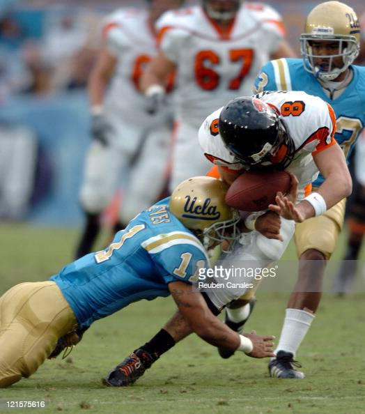 Free Safety Dennis Keyes of the UCLA Bruins tackles Beavers quarterback Matt Moore causing a fumble in a 25 to 7 victory over the Oregon State...