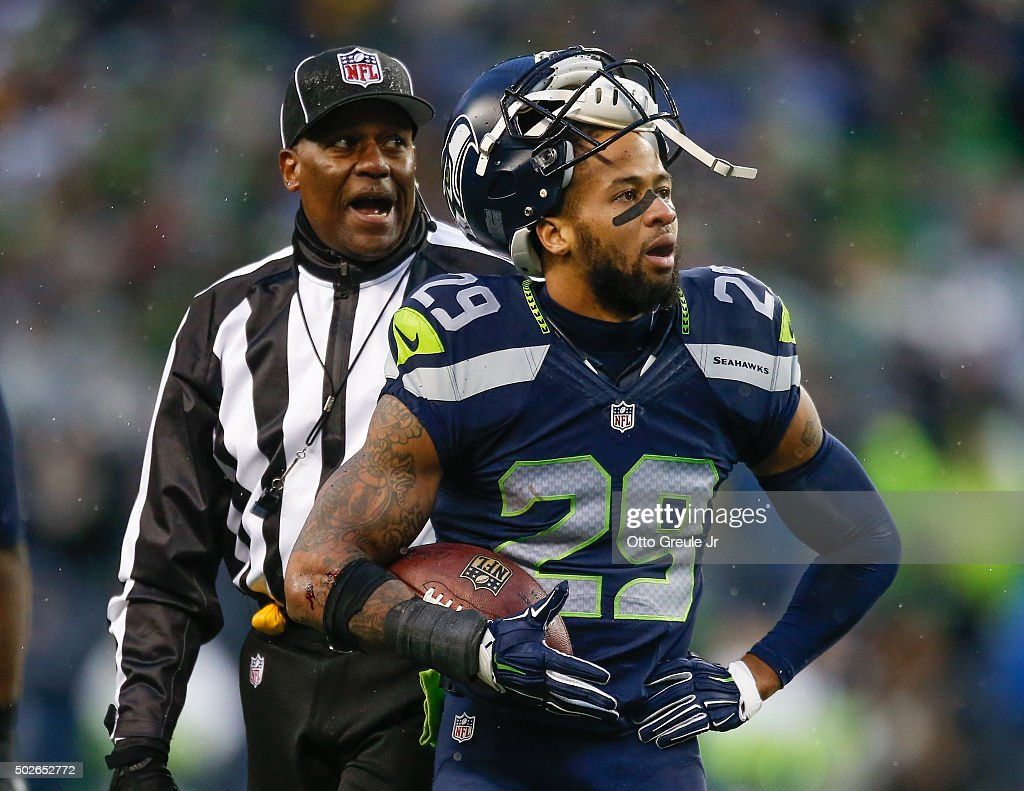Free safety Earl Thomas #29 of the Seattle Seahawks complains to the referee after he apparently recovered a fumble against the St. Louis Rams at CenturyLink Field on December 27, 2015 in Seattle, Washington. The officials ruled that the Rams recovered, and they went on to defeat the Seahawks 23-17.