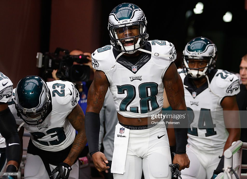 Free safety <a gi-track='captionPersonalityLinkClicked' href=/galleries/search?phrase=Earl+Wolff&family=editorial&specificpeople=6379729 ng-click='$event.stopPropagation()'>Earl Wolff</a> #28 of the Philadelphia Eagles leads teammates onto the field prior to the NFL game against the Arizona Cardinals at the University of Phoenix Stadium on October 26, 2014 in Glendale, Arizona.