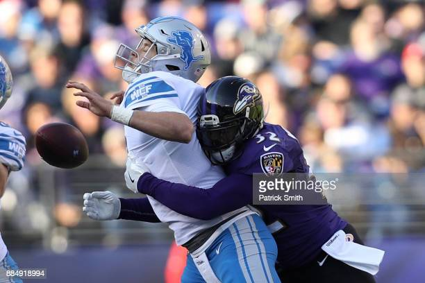 Free Safety Eric Weddle of the Baltimore Ravens forces a fumble as he tackles quarterback Matthew Stafford of the Detroit Lions at MT Bank Stadium on...