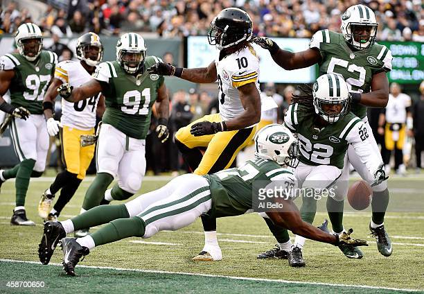 Free safety Jaiquawn Jarrett of the New York Jets dives to make an interception after the ball was tipped by wide receiver Martavis Bryant of the...