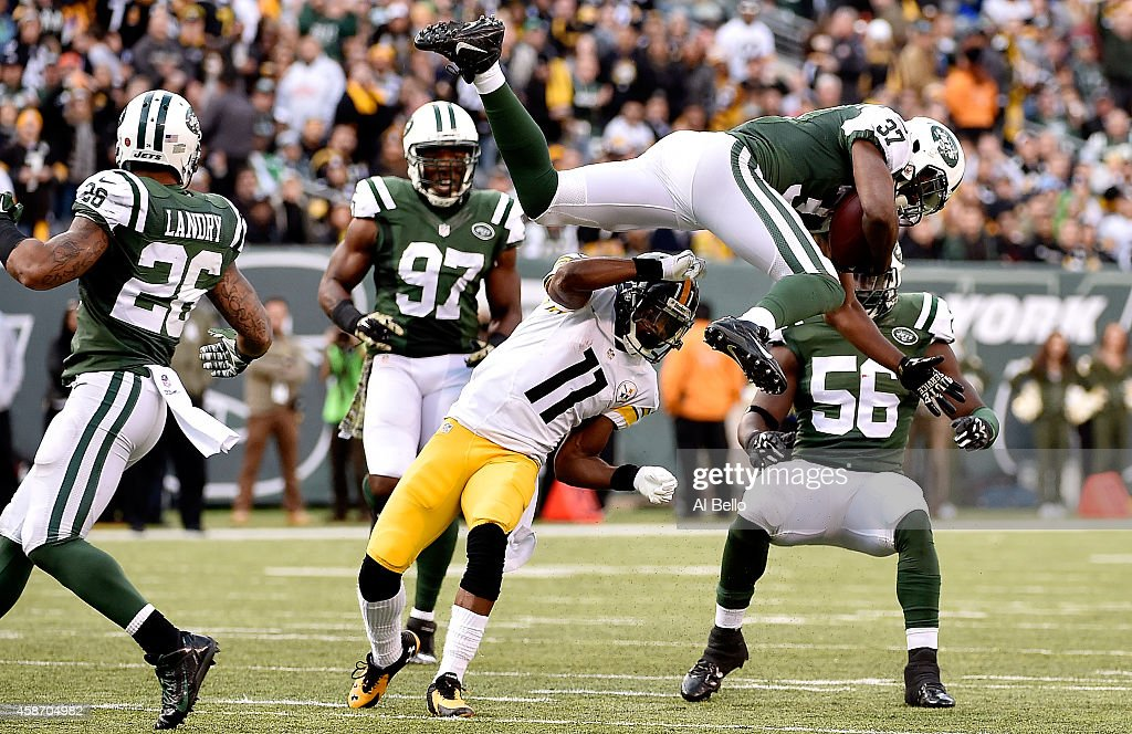 Free safety Jaiquawn Jarrett #37 of the New York Jets intercepts a ball intended for wide receiver Markus Wheaton #11 of the Pittsburgh Steelers during a game at MetLife Stadium on November 9, 2014 in East Rutherford, New Jersey.