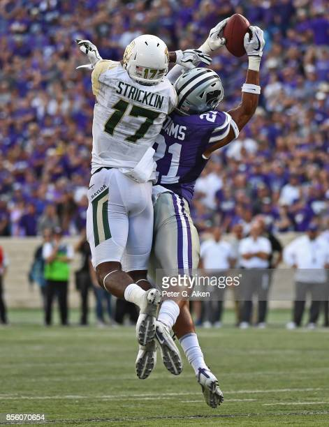 Free safety Kendall Adams of the Kansas State Wildcats intercepts a pass intended for wide receiver Pooh Stricklin of the Baylor Bears during the...