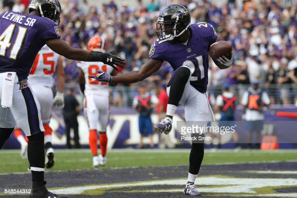 Free safety Lardarius Webb of the Baltimore Ravens and cornerback Anthony Levine of the Baltimore Ravens celebrate in the end zone against the...
