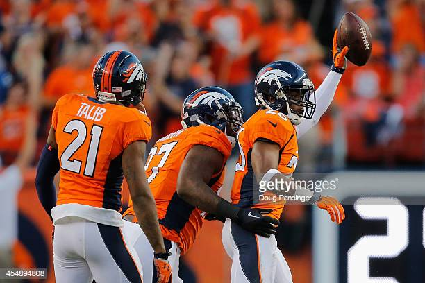 Free safety Rahim Moore of the Denver Broncos celebrates his interception against the Indianapolis Colts with teammates cornerback Aqib Talib and...