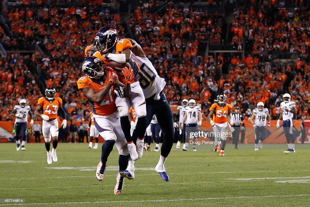 Free safety <a gi-track='captionPersonalityLinkClicked' href=/galleries/search?phrase=Rahim+Moore&family=editorial&specificpeople=5510817 ng-click='$event.stopPropagation()'>Rahim Moore</a> #26 of the Denver Broncos has a fourth quarter interception on a pass intended for wide receiver <a gi-track='captionPersonalityLinkClicked' href=/galleries/search?phrase=Malcom+Floyd&family=editorial&specificpeople=583121 ng-click='$event.stopPropagation()'>Malcom Floyd</a> #80 of the San Diego Chargers as cornerback <a gi-track='captionPersonalityLinkClicked' href=/galleries/search?phrase=Aqib+Talib&family=editorial&specificpeople=4037138 ng-click='$event.stopPropagation()'>Aqib Talib</a> #21 is also in on the play at Sports Authority Field at Mile High on October 23, 2014 in Denver, Colorado.