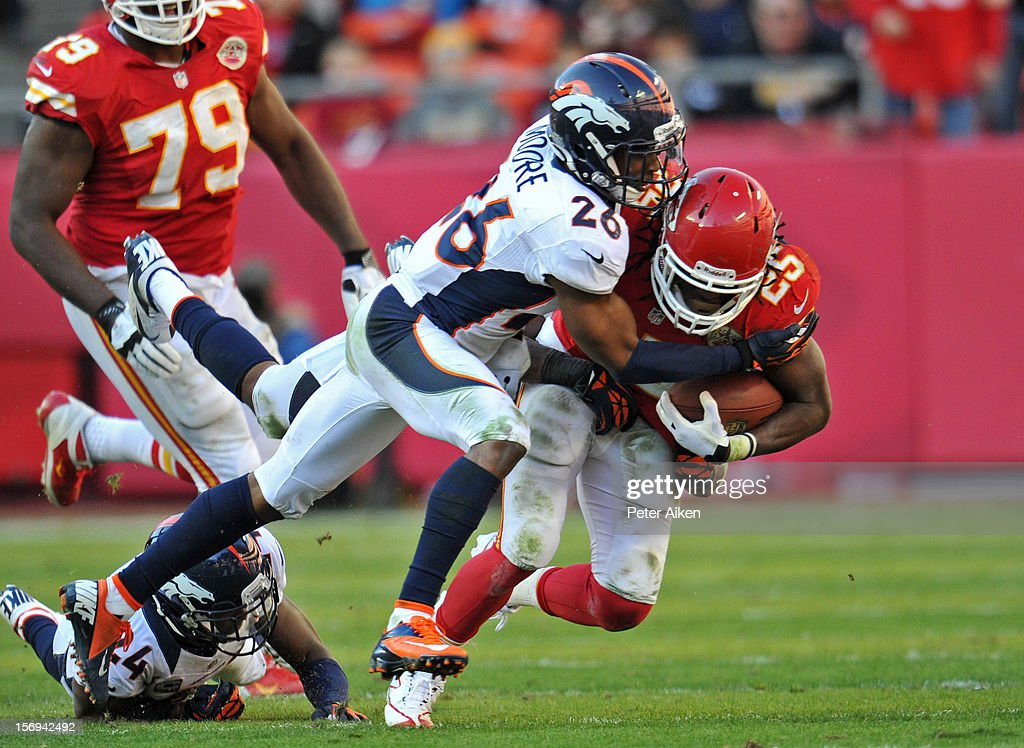 Free safety Rahim Moore #26 of the Denver Broncos tackles running back Jamaal Charles #25 of the Kansas City Chiefs during the second half on November 25, 2012 at Arrowhead Stadium in Kansas City, Missouri. Denver defeated Kansas City 17-9.