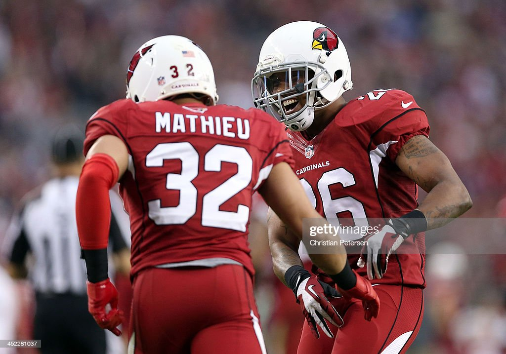 Free safety Rashad Johnson of the Arizona Cardinals congratulates Tyrann Mathieu after a stop against the Indianapolis Colts during the NFL game at...