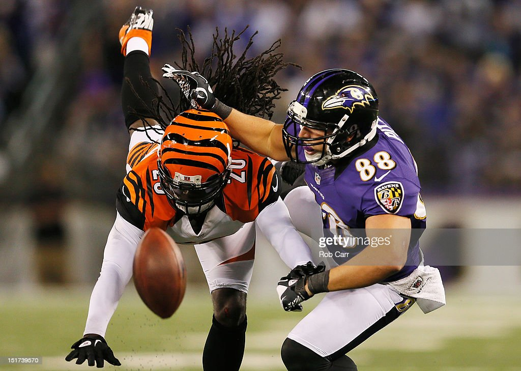 Free safety <a gi-track='captionPersonalityLinkClicked' href=/galleries/search?phrase=Reggie+Nelson&family=editorial&specificpeople=2141088 ng-click='$event.stopPropagation()'>Reggie Nelson</a> #20 of the Cincinnati Bengals breaks up a pass intended for tight end Dennis Pitta #88 of the Baltimore Ravens during the second half at M&T Bank Stadium on September 10, 2012 in Baltimore, Maryland.