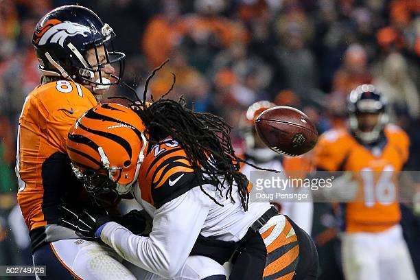 Free safety Reggie Nelson of the Cincinnati Bengals hits tight end Owen Daniels of the Denver Broncos causing an incompletion in the overtime period...
