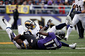 Free safety Rodney McLeod of the St Louis Rams defensive tackle Nick Fairley of the St Louis Rams tackle wide receiver Jeremy Butler of the Baltimore...