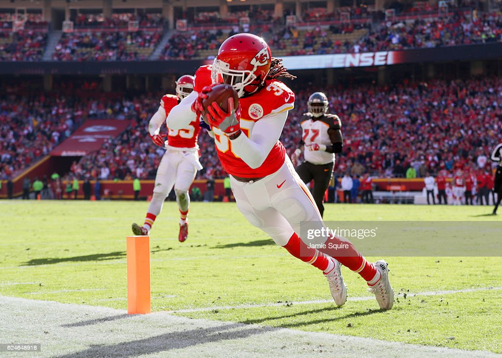 Free safety Ron Parker #38 of the Kansas City Chiefs stretches to intercept a pass from quarterback Jameis Winston #3 of the Tampa Bay Buccaneers that would be dropped as he hit the ground at Arrowhead Stadium during the second quarter of the game on November 20, 2016 in Kansas City, Missouri.