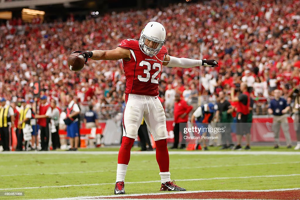 Free safety Tyrann Mathieu of the Arizona Cardinals celebrates after an interception during the second quarter of the NFL game against the San...