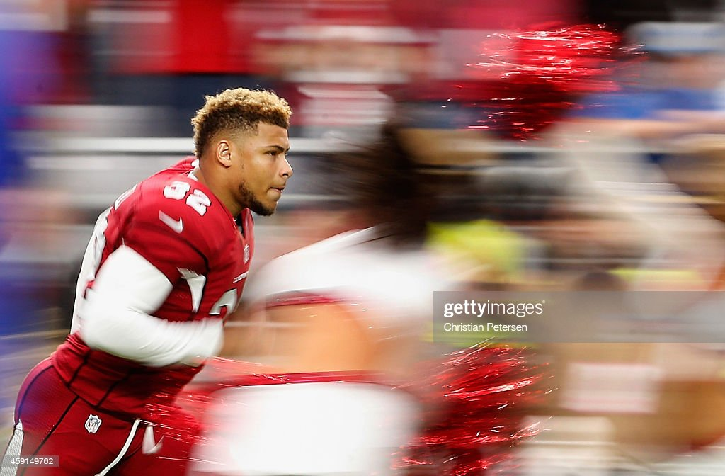 Free safety Tyrann Mathieu of the Arizona Cardinals runs out onto the field before the NFL game against the Detroit Lions at the University of...