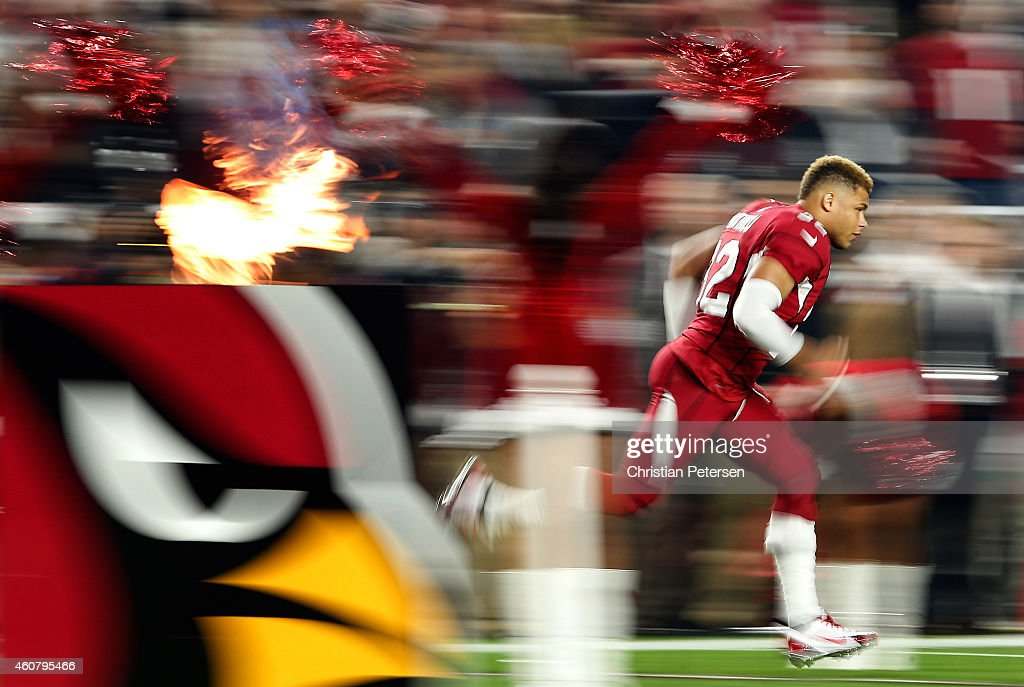 Free safety Tyrann Mathieu of the Arizona Cardinals runs out onto the field before the NFL game against the Seattle Seahawks at the University of...