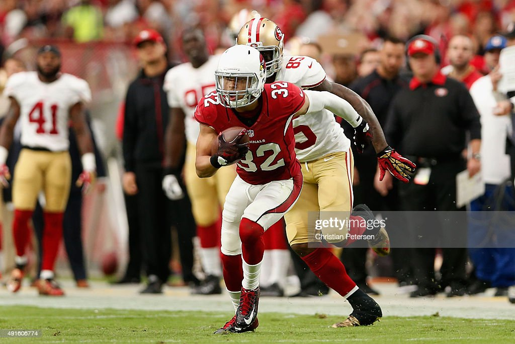 Free safety Tyrann Mathieu of the Arizona Cardinals runs with the football after an interception against the San Francisco 49ers during the NFL game...