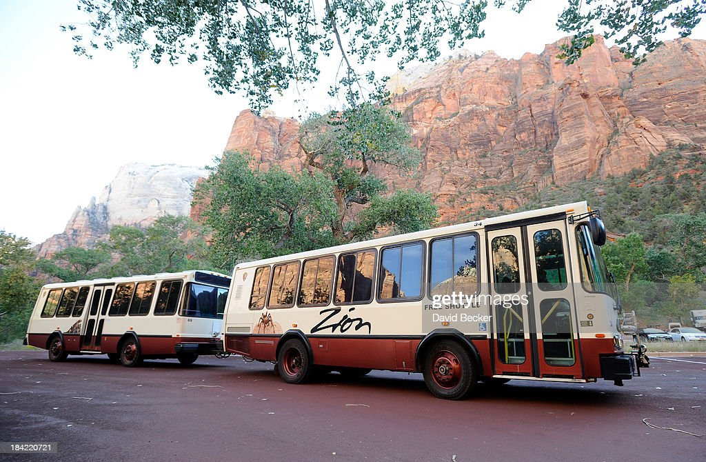 Free shuttle buses that ferry visitors along the Zion Canyon Scenic Drive are now operating inside the now open Zion National Park on October 12, 2013 in Springdale, Utah. The Obama administration said it would allow states to use their own money to reopen some national parks after a handful of governors made the request. Utah Gov. Gary Herbert said he reached an agreement to pay $166,572 a day to the Interior Department to open eight national sites in Utah.