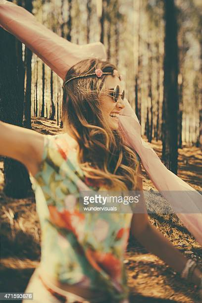 Free spirited vintage boho girl in a forest