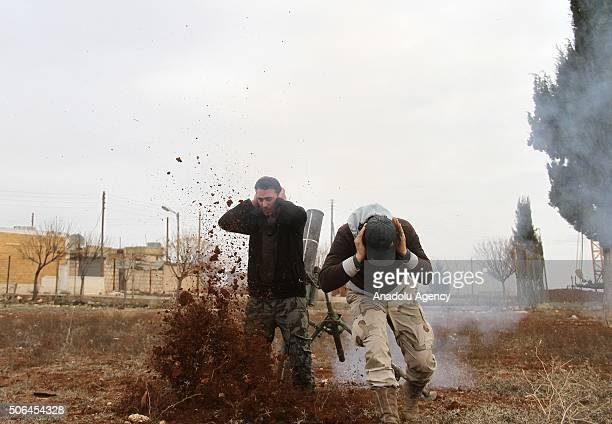 Free Syrian Army forces attack DAESH with heavy weapons at Baragid village following Daesh's attack at ElBil and Biriyte villages in the morning in...